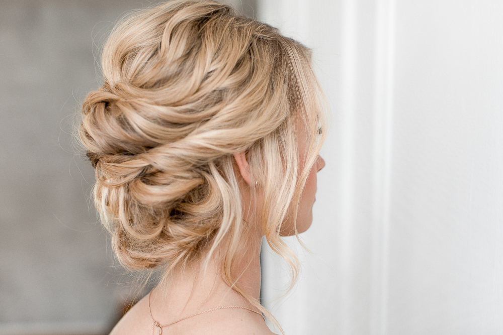 Pinned updo wedding hair
