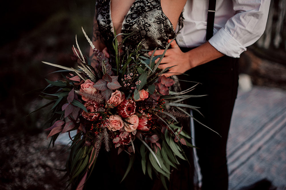 Alternative Wedding Dress with Macramé Moon Gate, Red King Protea Flowers and Sweetheart Table Planned by My Wedding Diario and Photographed by North Miles