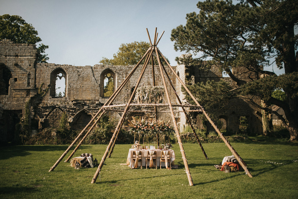 Naked Tipi Inspiration with Dried Grasses in Neutral Tones and Living Coral Wedding Flowers by My Pretties UK at Jervaulx Abbey by James Green Studios