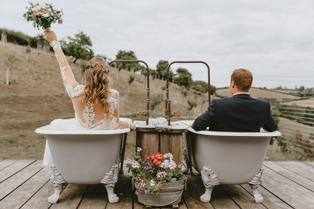 Devon Wedding Venues - Windout Barn in Exeter with Outdoor Twin Tubs, Pastel Wedding Flowers and Bride in Lace Wedding Dress by Wide Tide Weddings