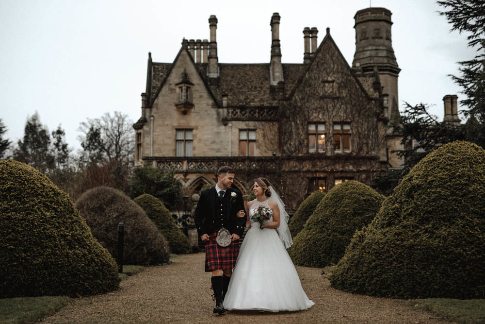 December Wedding at Manor by The Lake Country House in Gloucestershire with Christmas Theme, Kilts and Halterneck Wedding Dress by Taylor Hughes Photography