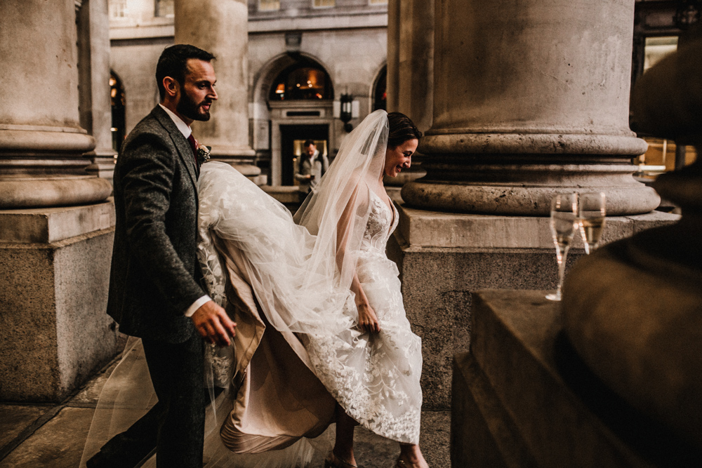 Jewish Blessing at Banking Hall in London with Aisle Lined in Tall Floral Arrangements and Bride in Hayley Paige Wedding Dress by Carla Blain Photography