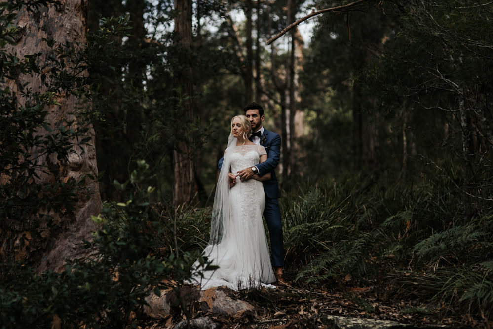 Bride In Rosa Clara Wedding Dress for an Outdoor Bush Ceremony at Sydney Royal National Park with Floral Arch by Damien Milan Photography