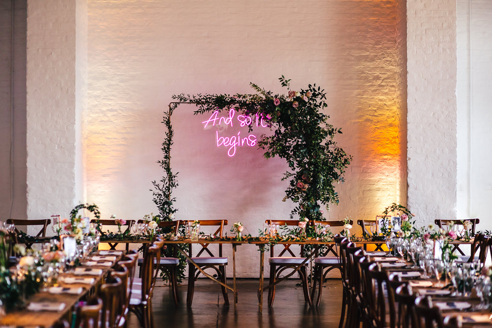 Trinity Buoy Wharf Wedding with Neon Wedding Sign and Copper Wedding Decor and Bride in Martina Liana Wedding Dress by Kirsty Mackenzie Photography