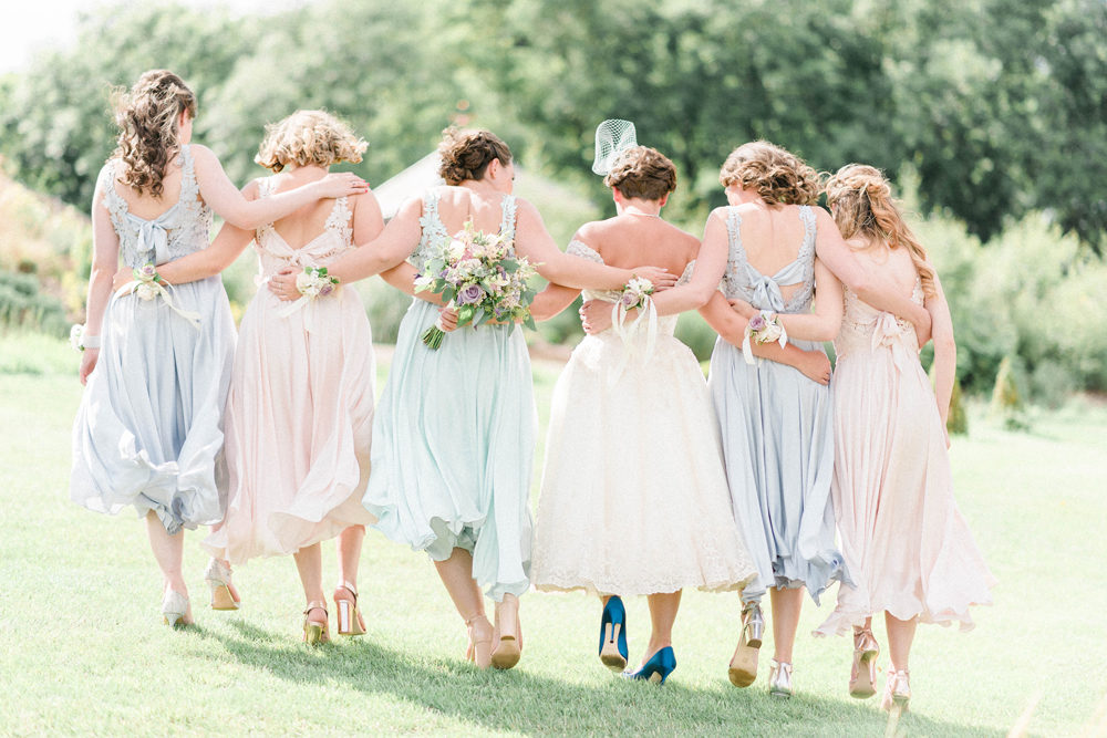 Bride in Tea Length Wedding Dress, Birdcage Wedding Veil and Blue Manolo Blahnik Hangisi Shoes for a Pastel Barn Wedding by Sarah-Jane Ethan Photography