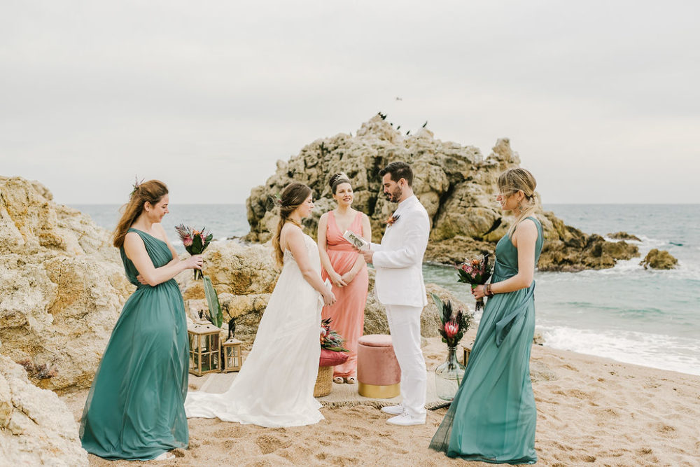 Intimate Beach Wedding Elopement in Barcelona with Beach Wedding Dress, White Suit and Protea Bouquet by CheChic Weddings & Rossella Putino Photography