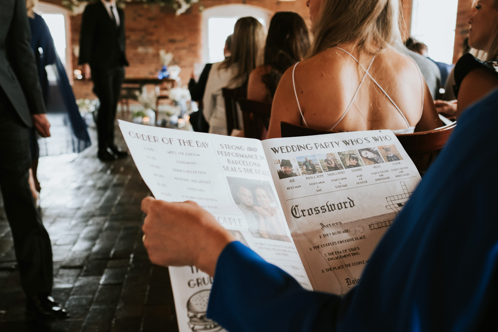 Wedding Newspaper Order of Service and Blue and White China for Industrial Wedding at The West Mill in Derbyshire by Rosie Kelly Photography