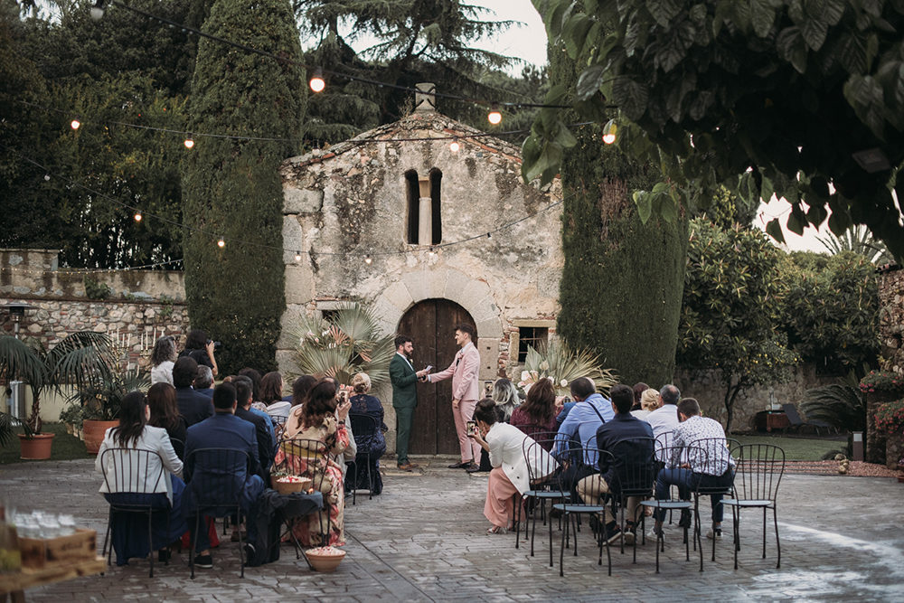 Two Grooms in Pink Wedding Suit and Green Wedding Suit for an Intimate Barcelona Wedding with Dried Plam Leaves Decor by La Dichosa Photography