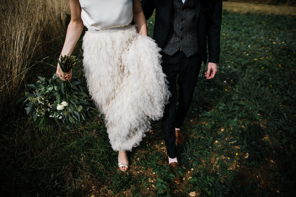 Halfpenny London Swan Tulle Petal Bridal Skirt for a Stylish Barn Wedding at Stone Barn in the Cotswolds by Through The Woods We Ran Photography