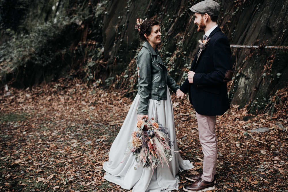Bride Wears a Silver Skirt for a Forest Wedding with Tipi Reception, Macrame Backdrop and Dried Wedding Flowers by Francesca Hill Photography
