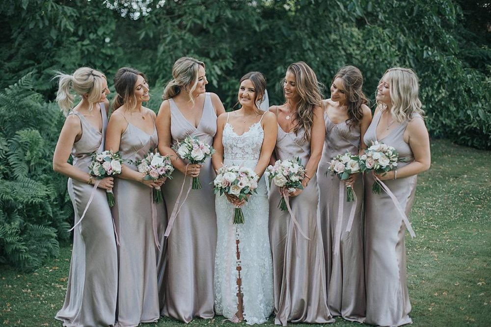 Satin Bridesmaid Dresses for Botanical Wedding in a Great Conservatory in Essex with Bride in Lace Emmy Mae Wedding Dress at Syon Park by Julia & You