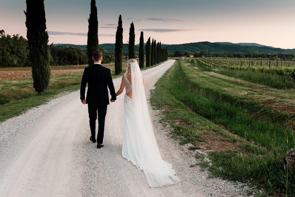Southern Tuscany Wedding at Conti di San Bonifacio Venue with Badgley Mischka Wedding Dress and Blue Bridesmaid Dresses by Georgina Brewster Photography