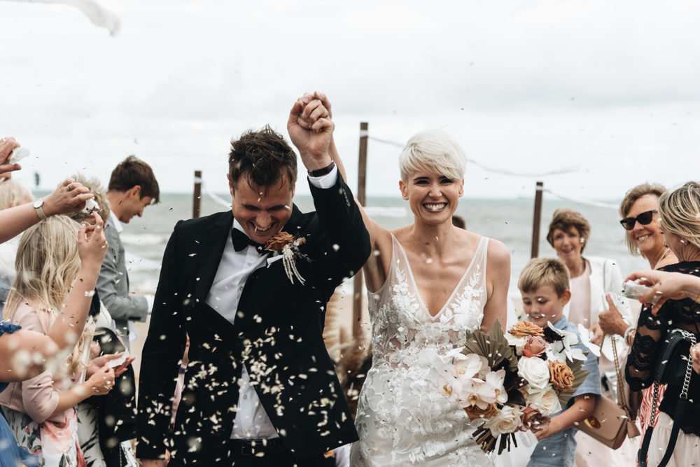 Bride with Short Hair in Lace Made With Love Wedding Dress for a Contemporary Wedding in the Netherlands by Jeroen Noordzij Photography