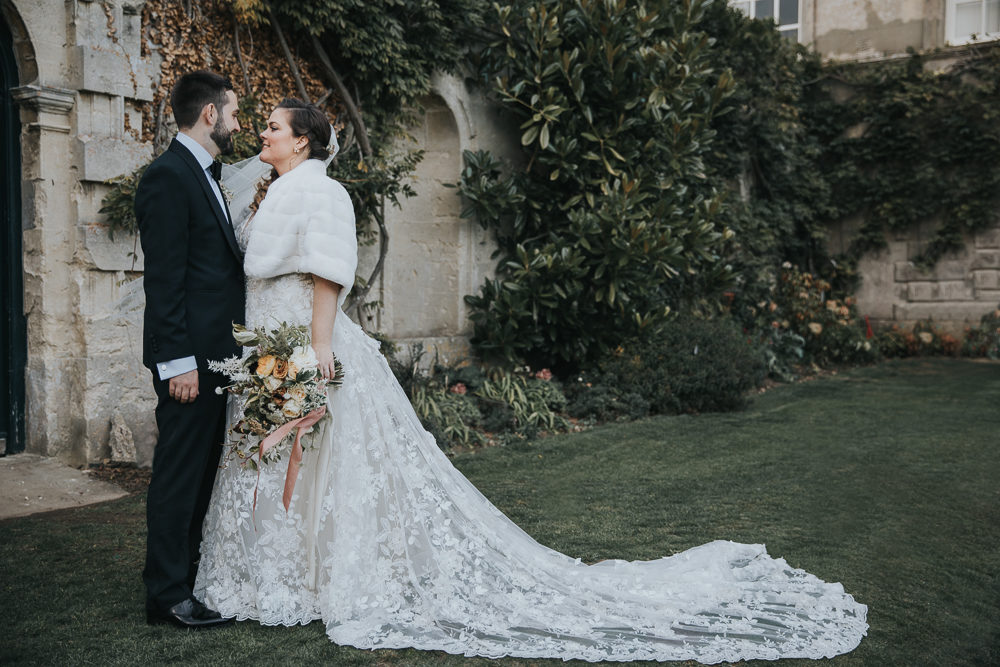 Winter Celebration at Oxfordshire Wedding Venue with Ceilidh Party, Bride in Gemy Maalouf Wedding Dress with Faux Fur Coverup by Poppy Carter Photography