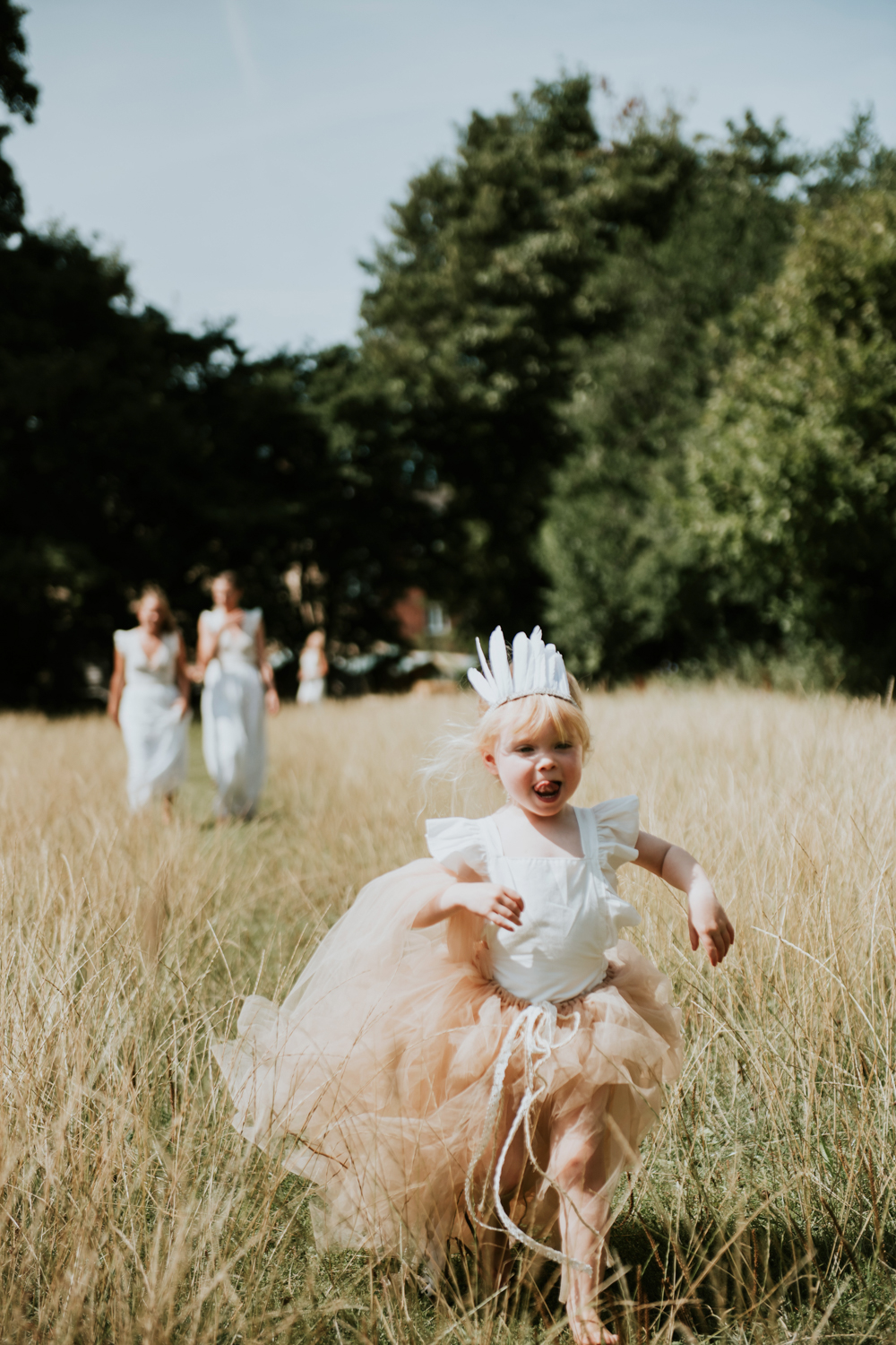 28d929be2fd Flower Girl In White Feather Crown    Image By Rosie Kelly Photography