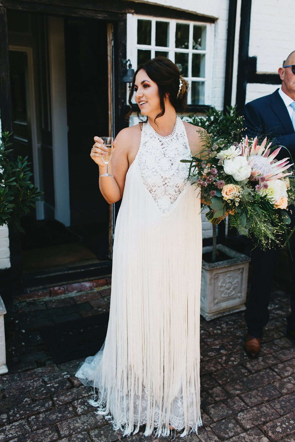 d5fd4d24d2c Fringed Wedding Dress By Yolan Cris    Image By Jason Williams Photography