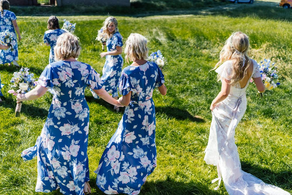 Blue Floral Bridesmaid Dresses For A Marquee Wedding With Wildflowers