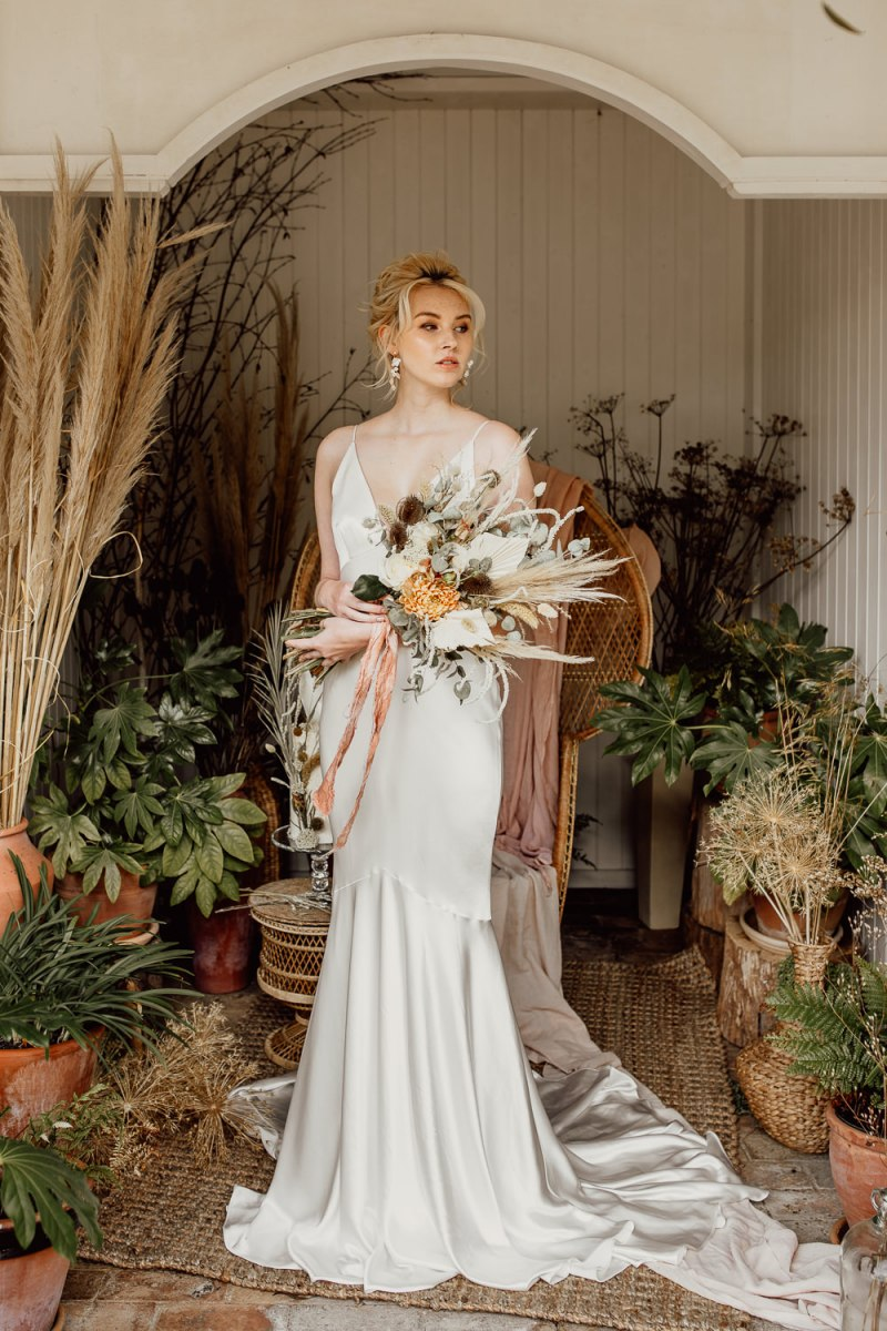 Minimalist Wedding Dress And Dried Wedding Flowers For A