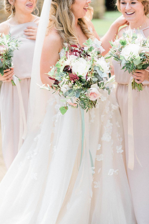 ac8b5271bde Bride in Strapless Liz Martinez Ballgown Wedding Dress with Embroidered  Flowers