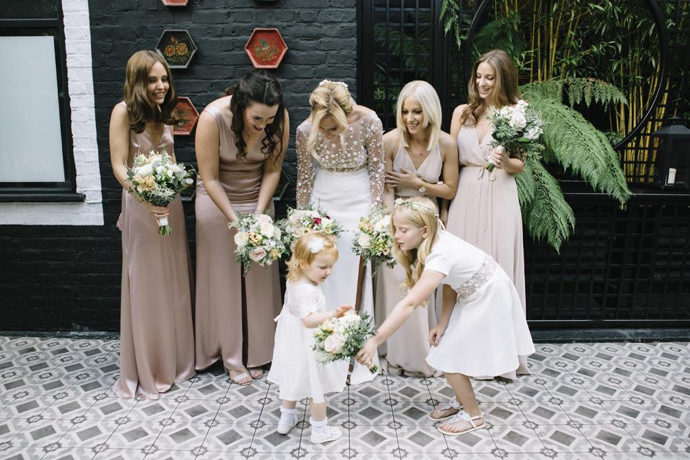 aca57a3e543 Bridesmaids In Reformation Dresses    Waterside Wedding Venue London  Winchester House Bride In Rime Arodaky
